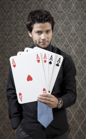 Confident young businessman show his hand to his opponent. photo