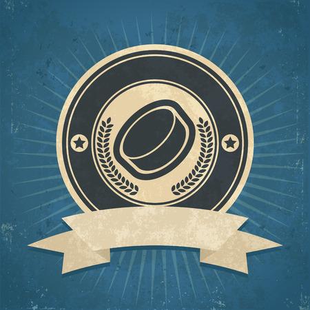 the puck: Retro grunge illustration of hockey puck emblem