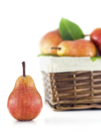 pit fall: Pear with a basket full of pears on a white background Stock Photo