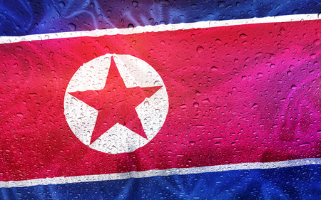 watter: North Korea, flag with watter drops, rainy weather