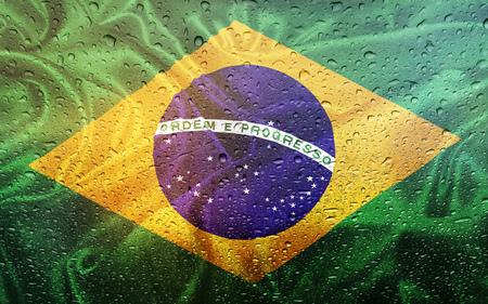 Brasilian flag with watter drops, rainy weather, Brasil