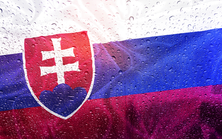 Slovak flag with watter drops, rainy weather, Slovakia