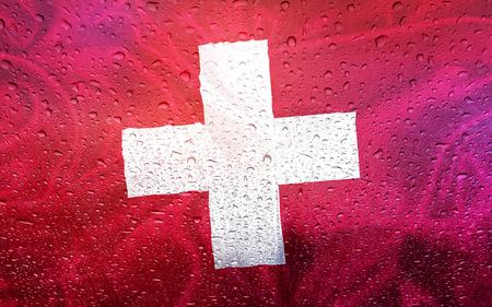 watter: Swiss flag with watter drops, rainy weather, Switzerland
