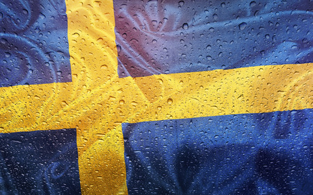 watter: Swedisch flag with watter drops, rainy weather, Sweden Stock Photo