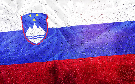 watter: Slovenia flag with watter drops, rainy weather Stock Photo