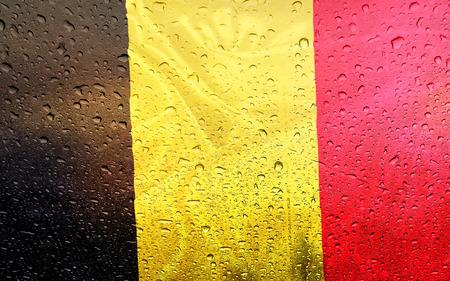 Belgian flag with watter drops, rainy weather, Belgium