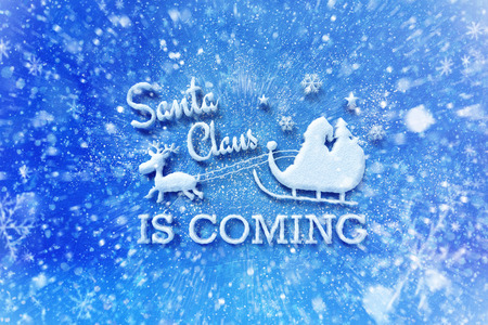 Santa Claus is coming lettering with snow effect, Christmas wish card with typography composition, Christmas card with snow effect and decoration