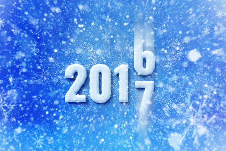 new year 2017 text with snow effect, happy new year lettering graphic with snowing and snowflakes 版權商用圖片