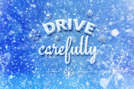 Drive carefully letters, snow automotive graphic background, driving winter background