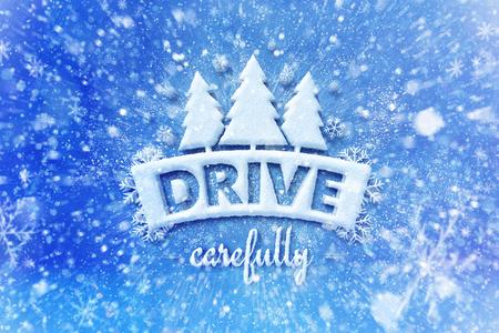 Rijd voorzichtig met het wintersymbool, een grahische achtergrond in de sneeuw en rij de achtergrond in de winter Stockfoto