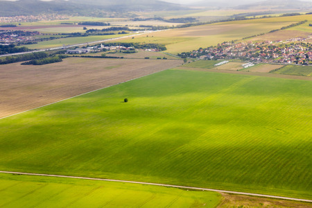 Aerial view of field from plane, slovak fields near Nitra, countryside from plane