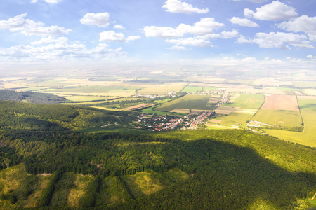 Aerial view of field with forest from plane, slovak fields near Nitra, countryside from plane