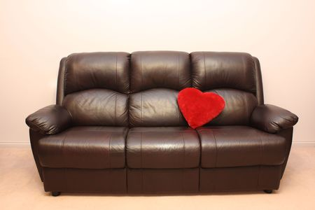leather couch with heart Stock Photo