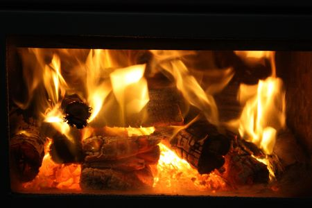Wood fire burning in the fireplace Stock Photo