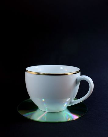 Cup on a CD coaster Stock Photo