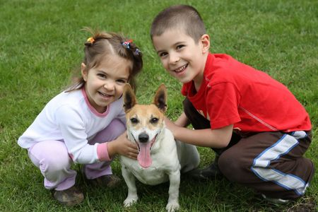 Two cute happy kids with dog Stock Photo - 7876601