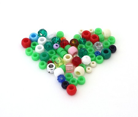 heart shape made of craft beads, isolated over white Stock Photo - 7986543