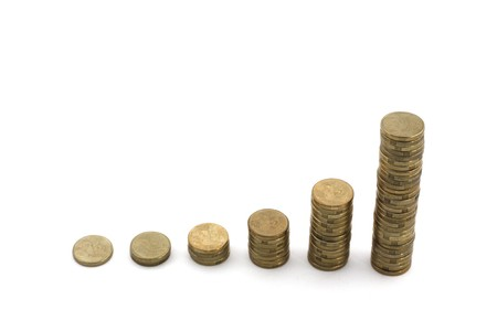Stacks of coins showing exponential growth, isolated over white.  Conceptual for profit, financial growth 스톡 사진