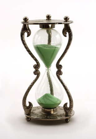 sand timer: Isolated retro hourglass with green sand Stock Photo