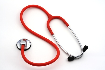 Single red stethoscope isolated over white Stock Photo - 9335254
