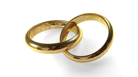 interlocked: Two golden wedding rings interlocked Stock Photo