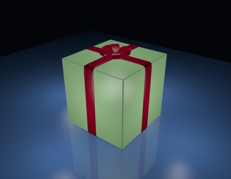 Green gift box wrapped in red ribbon, on blue and black background. photo