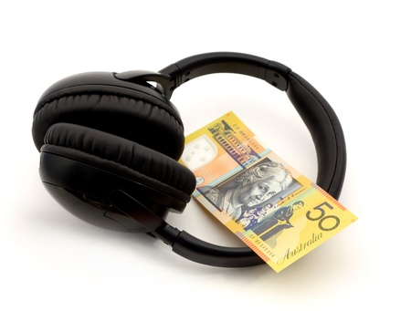 Headphones with 50 australian dollar note over white
