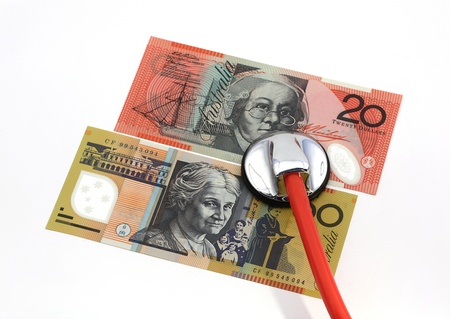 doctor giving dollars: Stethoscope with Australian banknotes, isolated over white