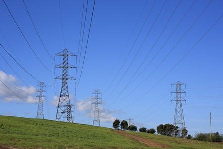 High voltage towers and transmission lines on a hill