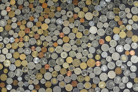 Background with many coins from different countries photo