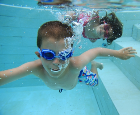 Boy and girl swimming underwater