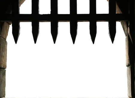 portcullis: Medieval castle gate with portcullis, with white background for copy space Stock Photo