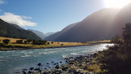 Beautiful sunny day at Mount Aspiring National Park, New Zealand, with river and mountains Stock Photo