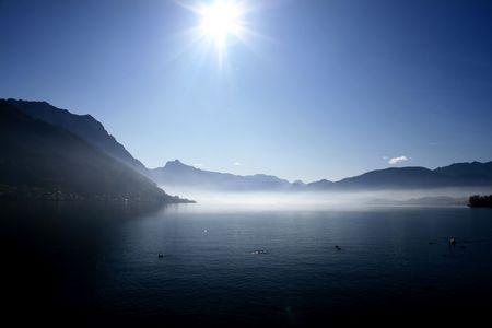 mountain landscape, lake and fog, mist, sun Stock Photo - 3892510
