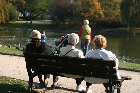 older women relaxing on the bench in the park