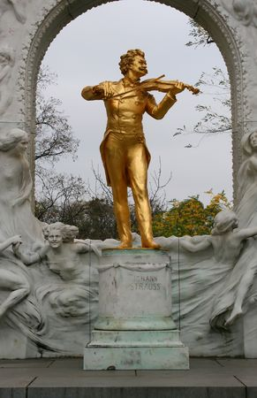 Johann Strauss golden statue in Vienna city park Stock Photo