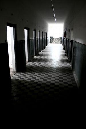 closed lock: claustrophobic prison corridor, cells, penitentiary, doors, closed, lock Stock Photo