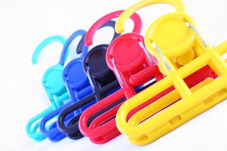 colorful laundry hangers isolated on white background photo