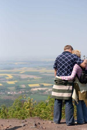 tourists, couple admiring beautiful landscape, love, mountain Stock Photo
