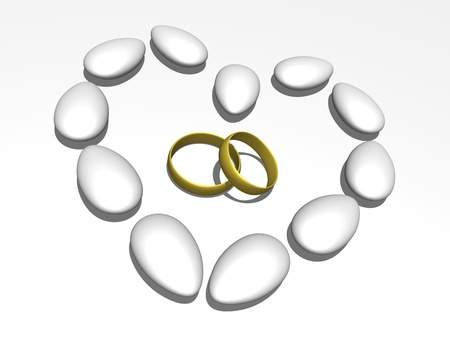 Wedding rings within a heart formed by sugared almonds