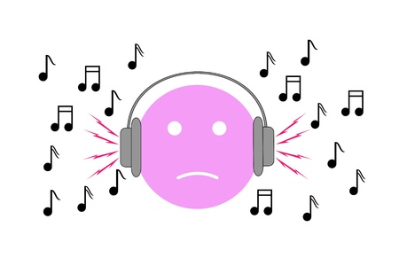 high damage: Boy listening to loud music with headphones