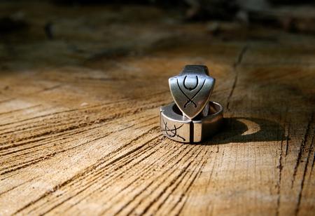 Two rings on the wood Фото со стока