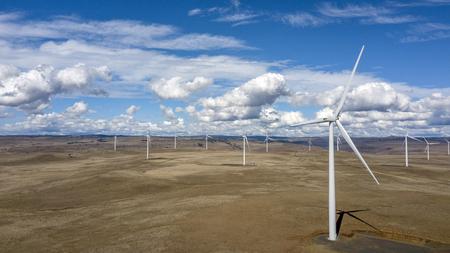 aerial photo of Wind farm over barren landscape Reklamní fotografie - 112236007