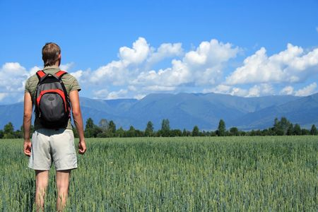 pilgrim journey: one person costs in a floor and looks at mountains