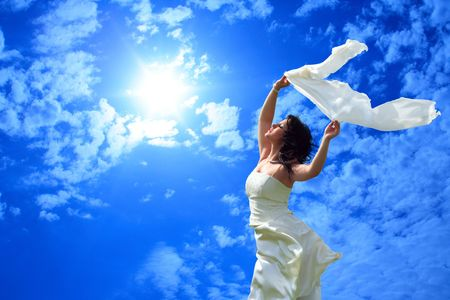 soulfulness: young girl on a background of the blue sky