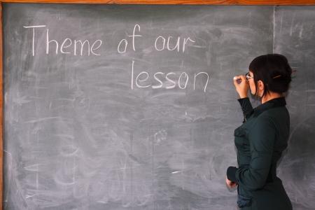woman writes on a blackboard Stock Photo - 5577016