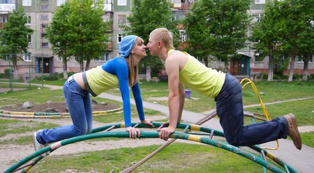 enamoured: young man and the woman together outside