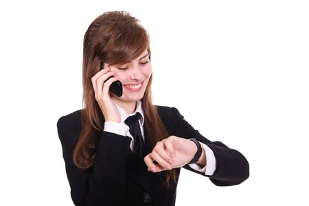tardy: business women speaks by phone and looks at the wrist watch