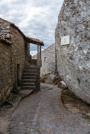 Narrow street of Monsanto vollage with rocks Stock fotó