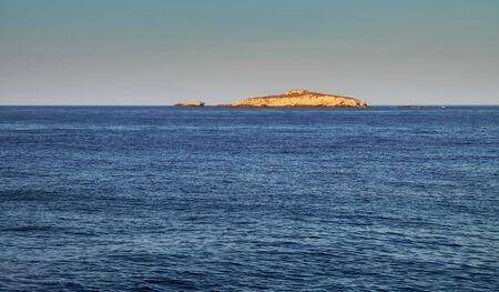 A peaceful view of the Mediterranean Sea from Cyprus. Afroditi Akraia. Cape Apostolos Andreas. Karpass Peninsula. Cape Saint Andrew. Zafer Burnu. Cape Victory Фото со стока